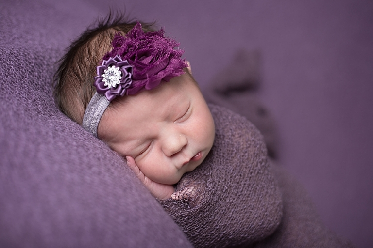 Newborn girl in purple bismarck nd newborn photographer mandy moracco photography